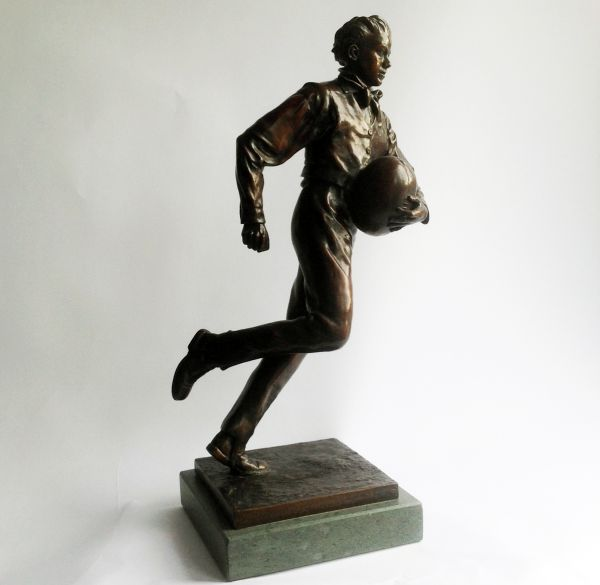 Bronze on Slate Sport sculpture by sculptor Graham Ibbeson titled: 'William Webb Ellis sculpture (Rugby Player statuette)'
