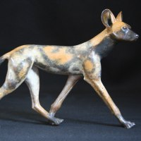 African Animal and Wildlife Sculpture by sculptor artist Adam Binder titled: 'Painted Dog (Small Bronze Wild Dog sculptures statuettes)' in Bronze