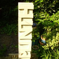 'Plinth (Precision Carved Raised Lettering garden Carving/statue/sculpture)' by Anna Louise Parker