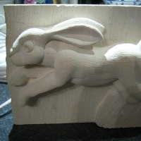 Wild Animals and Wild Life Sculpture by sculptor artist Anthony Bartyla titled: 'Hare Running (Carved High Relief Panel Carvings)' in Ancaster limestone