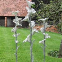 'Flora - group of 3 (Contemporary Big garden statue)' by Carole Andrews