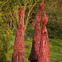Outsize Big Large Fruit Flower Plant sculpture statue statuaryGarden Ornament by sculptor artist Carole Andrews titled: 'Red Sentinels (Contemporary Floral garden statues)' in Roofing felt, steel, polyurenthane, resi