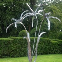 Plant Outdoor Outside Garden or Yard sculpture statue statuette by sculptor artist Colleen du Pon titled: 'Firework Flower (Large Outsized abstract Stylized Flower sculpture)' in Mild steel, forged