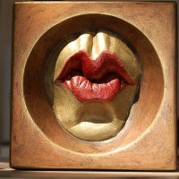 Mask, Wall Hung Faces and Part Heads by sculptor artist Edward Fleming titled: 'Dame Fun Beso (Framed Pursed Kissing Lips sculpture)' in Bronze