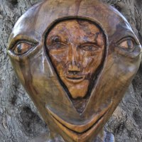 Mask, Wall Hung Faces and Part Heads by sculptor artist Eric Kempson titled: 'Split personality. (Semi abstract Contemporary faceWood carving)' in Olive wood