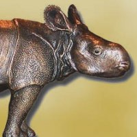 Asian Animals Reptiles Insects or Birds Sculpture or Statues by sculptor artist Ernst Paulduro titled: 'Baby Indian Rhinoceros ALBRECHT (Little Rhino statue)' in Bronze