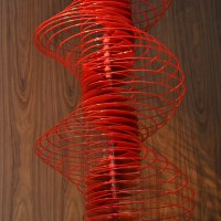 Kinetic or Mobile Sculpture or Statue by sculptor artist Ivan Black titled: 'Red Serpentine (Suspended Coloured Red Helix sculptures)' in Aluminium