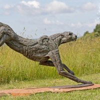 'Big Landing Cheetah (Lifesize Springing Big Cat statue)' by Jan Sweeney