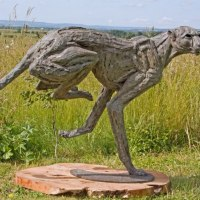'Big Turning Cheetah (Running life size Big Cat statue)' by Jan Sweeney