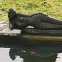 Pool, Pond, Lake Stream or River Water Feature by sculptor artist Janis Ridley titled: 'Dreaming of Being (Bronze nude Lying by Pool Naked Girl female statue)' in Bronze