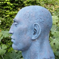 Mask, Wall Hung Faces and Part Heads by sculptor artist Lucy Kinsella titled: 'Monumental Blue Head (Oversize Big garden sculpture)' in Bronze resin