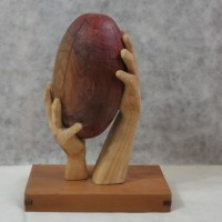 Carved Wood Sculpture by sculptor artist Luigi Bartolini titled: 'Two Hands, One Ball (Carved Rugby Ball sculpture)' in Lime, eucaliptus woods