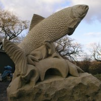Wild Animals and Wild Life Sculpture by sculptor artist Martyn Bednarczuk titled: 'Salmon (Leaping Carved stone Outdoor garden/Yard statues sculpture)' in Sandstone