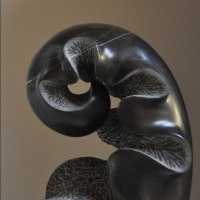 Small / Little Abstract Contemporary Sculpture / Statues by sculptor artist Nando Alvarez titled: 'Black Sprout (Black Carved Young Fern Frond statues)' in Black stone
