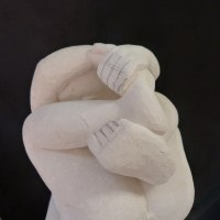 Nude sculpture statue statuette Figurine Ornament by sculptor artist Patrick Barker titled: 'In a tangle (Fun Curled up Man Stone garden statues)' in French limestone
