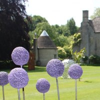 Plant Outdoor Outside Garden or Yard sculpture statue statuette by sculptor artist Paul Cox titled: 'Allium Field (life size Onion Flowers sculptures statue)'