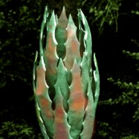 Plant Outdoor Outside Garden or Yard sculpture statue statuette by sculptor artist Peter M Clarke titled: 'Seed Pod lll (Big Outsize abstract Flowerbud statue)' in Copper on oak plinth