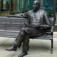Busts and Heads Sculpture Statues statuettes Commissions Bespoke Custom Portrait Memorial Commemorative sculpture or statue by sculptor artist Richard Austin titled: 'Sir Malcolm Arnold (Man Seated on Park Bench statue)' in Resin composite
