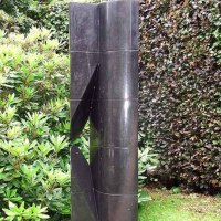 'Upright (Tall Carved Black Granite abstract Modern Columnar sculptures)' by Rob J Maingay