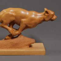 Asian Animals Reptiles Insects or Birds Sculpture or Statues by sculptor artist Sergey Chechenov titled: 'Hunting (Cheetah Carved Wood Running Chasing statue)' in Wood:ash bolivian