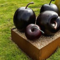 Outsize Big Large Fruit Flower Plant sculpture statue statuaryGarden Ornament by sculptor artist Simon Gudgeon titled: 'Cherry (single) (Bronze Red Outdoor garden sculpture)' in Bronze