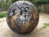 Kinetic or Mobile Sculpture or Statue by sculptor artist Aragorn Dick-Read titled: 'Fireball III (Large Spherical Outdoor statues)' in Steel / iron