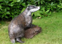 Badger, Otter, Beaver, Weasel, Stoat, Pine Martin, Wombat Sculpture by sculptor artist Christa Hunter titled: 'Into the Moonlight (Playful life size Young Badger statues/sculptures)' in Bronze resin