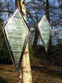 Kinetic or Mobile Sculpture or Statue by sculptor artist Jane Bohane titled: 'Incognito (abstract Contemporary Coloured Glass garden Panel statues)' in Stainless steel. stained glass