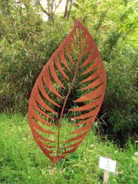 Outsize Big Large Fruit Flower Plant sculpture statue statuaryGarden Ornament by sculptor artist Peter M Clarke titled: 'Leaf Form II (Big Contemporary Leaf Yard sculpture)' in Mild steel