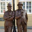 Bronze Famous People Sculptures Statues sculpture by Graham Ibbeson titled: 'Laurel and Hardy (Bronze life size Film Star sculpture/statue)'